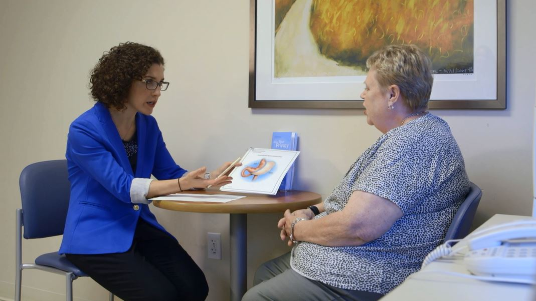 Dr. Laura Doyon talks with a patient